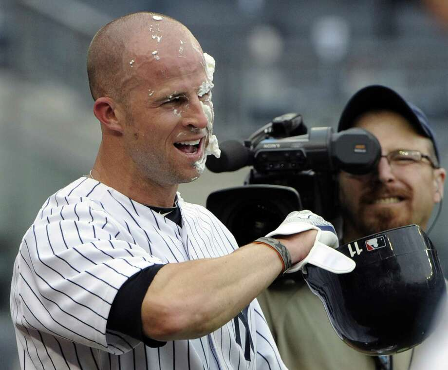 New York Yankees' Brett Gardner reacts after being hit in the face with shaving cream by A. J. Burnett while being interviewed after driving in the game-winning run during the 12th inning of a baseball game against the Texas Rangers, Thursday, June 16, 2011, at Yankee Stadium in New York. The Yankees won 3-2. (AP Photo/Bill Kostroun) Photo: ASSOCIATED PRESS / AP2011