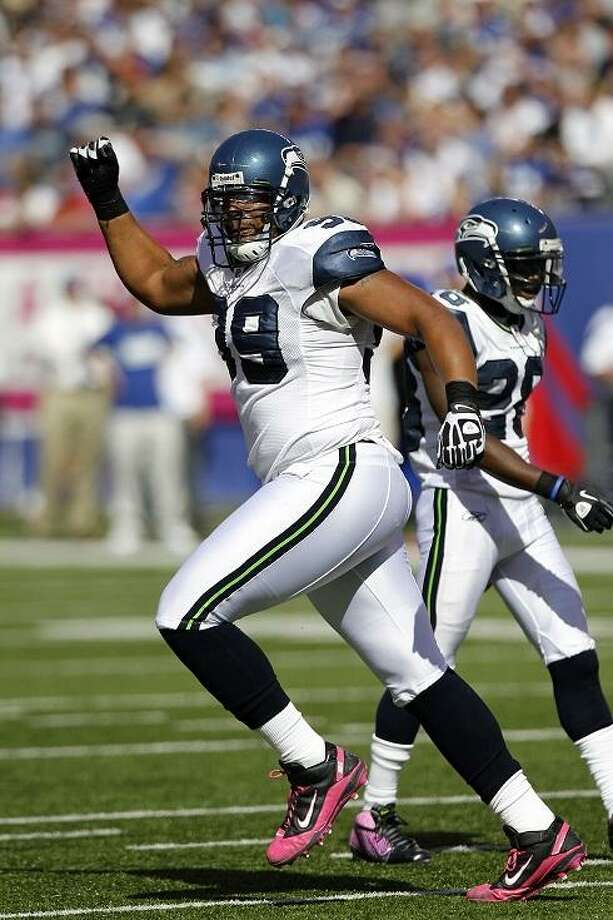 Seattle Seahawks defensive tackle Alan Branch (99) celebrates after the Seahawks recover a first quarter fumble by the New York Giants during the NFL week 5 football game against the New York Giants on Sunday, October 9, 2011 in East Rutherford, New Jersey. The Seahawks won the game 36-25. (AP Photo/Paul Spinelli) Photo: ASSOCIATED PRESS / AP2011