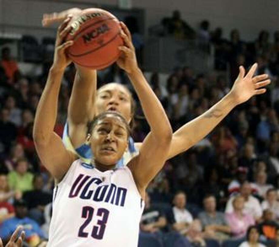 (AP) Connecticut's Maya Moore shoots over Southern's Jamie Floyd during second half action of their NCAA college basketball game, Sunday, at the Constant Center in Norfolk, Va. Connecticut beat Southern 95-39. Photo: AP / FRE170070
