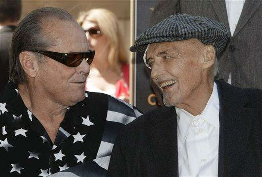 (AP) Actor Jack Nicholson, left, congratulates Dennis Hopper after being honored with a star on the Hollywood Walk of Fame on Friday in Los Angeles. Photo: AP / AP