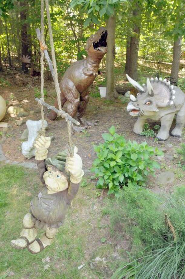 Not everybody has a tyrannosaurus rex or a swinging leprechaun in their yard. (Peter Hvizdak/Journal Register News Service)