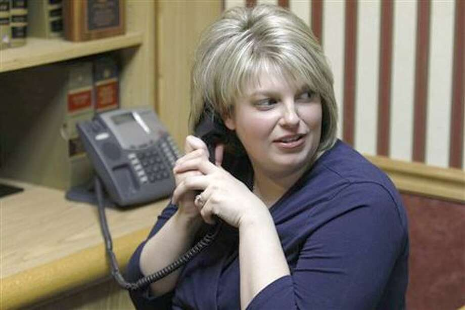 Central Bucks, Pa.,  East High School teacher Natalie Munroe is seen while on hold during a phone interview at her attorneys office in Feasterville, Pa., Tuesday, Feb. 15, 2011. Munroe, suspended from her job over profanity-laced posts on her blog, says she was speaking the truth about students who are unwilling to work hard at school.   (AP Photo/Matt Rourke) Photo: AP / AP