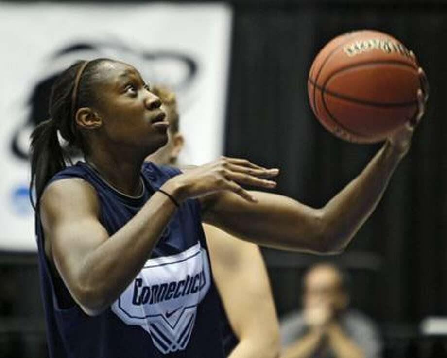 Connecticut's Tina Charles shoots during practice for the women's NCAA basketball Dayton Regional Saturday. (Associated Press) Photo: ASSOCIATED PRESS / AP2010
