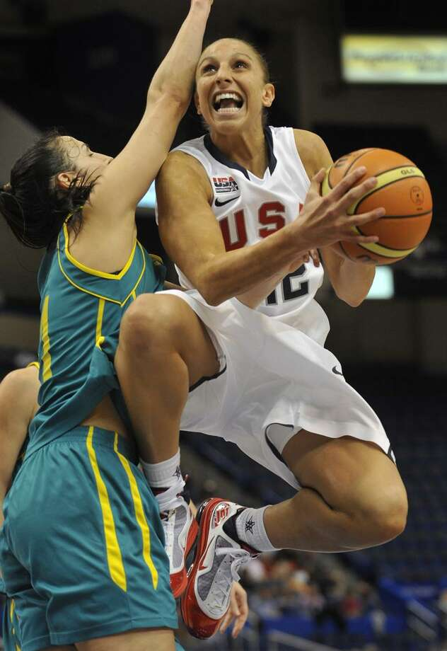USA's Diana Taurasi drives to the basket while guarded by Australia's Laura Summerton, left,  during the second half of an exhibition basketball game in Hartford, Conn., on Friday, Sept. 10, 2010. (AP Photo/Jessica Hill) / AP2010
