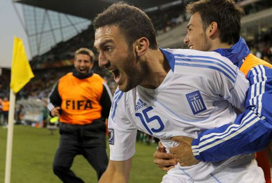 Greece's Vassilis Torosidis, center, celebrates after scoring during the World Cup group B soccer match between Greece and Nigeria at Free State Stadium in Bloemfontein, South Africa, Thursday.  (AP) Photo: ASSOCIATED PRESS / AP