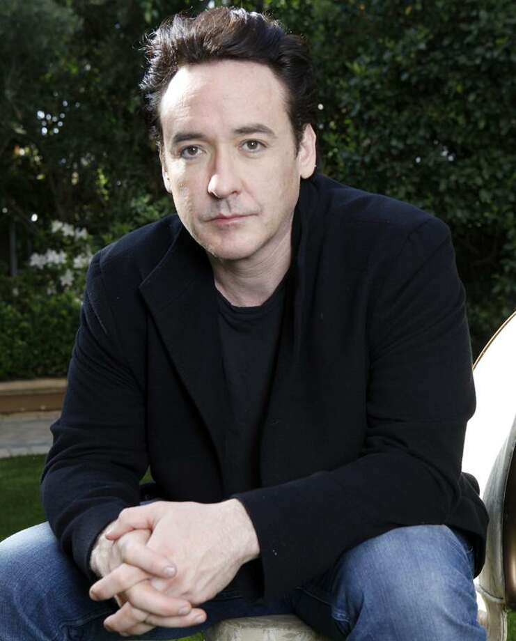 In this March 20 photo, actor John Cusack poses for a portrait in Los Angeles. (AP) Photo: AP / AP