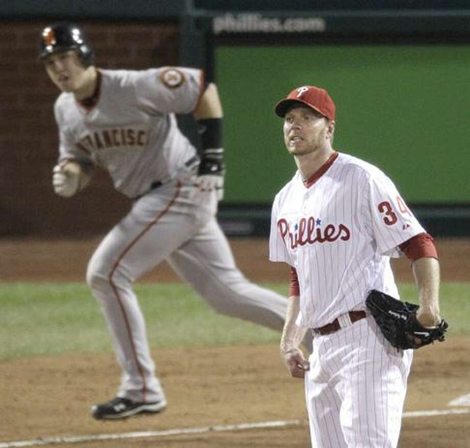 Philadelphia Phillies starting pitcher Roy Halladay watches a single hit by San Francisco Giants' Buster Posey during the sixth inning of Game 1 of baseball's National League Championship Series Saturday, Oct. 16, 2010, in Philadelphia. (AP Photo/Eric Gay) Photo: ASSOCIATED PRESS / AP