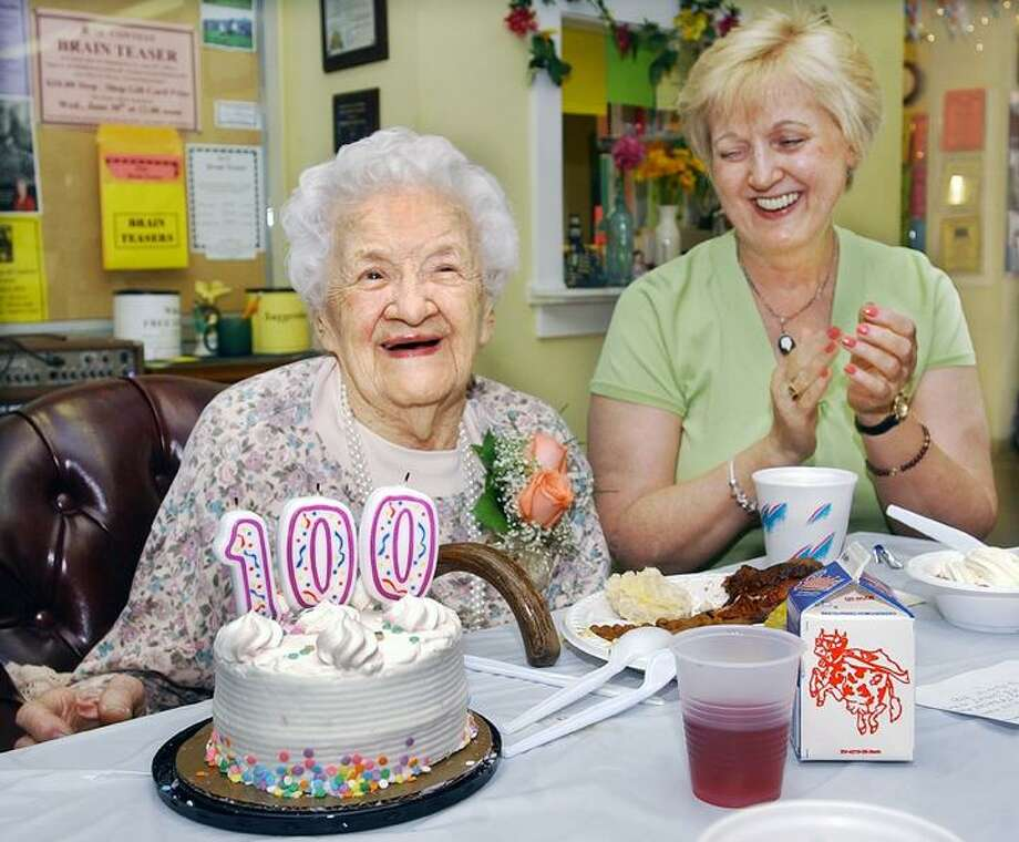 """The Middletown Press  6.17.10  Middletown resident Tony Salafia giver her good friend Adeline Pusz a birthday kiss at a 100th birthday celebration held at the Middletown Senior Center. To buy a glossy print of this photo and more, visit <a href=""""http://www.middletownpress.com"""">www.middletownpress.com</a>."""