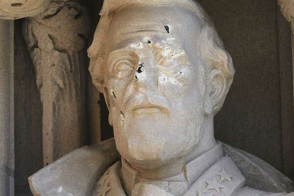 The defaced Gen. Robert E. Lee statue stands at the Duke Chapel on Thursday, Aug. 17 in Durham, N.C.   (Bernard Thomas/The Herald-Sun via AP)