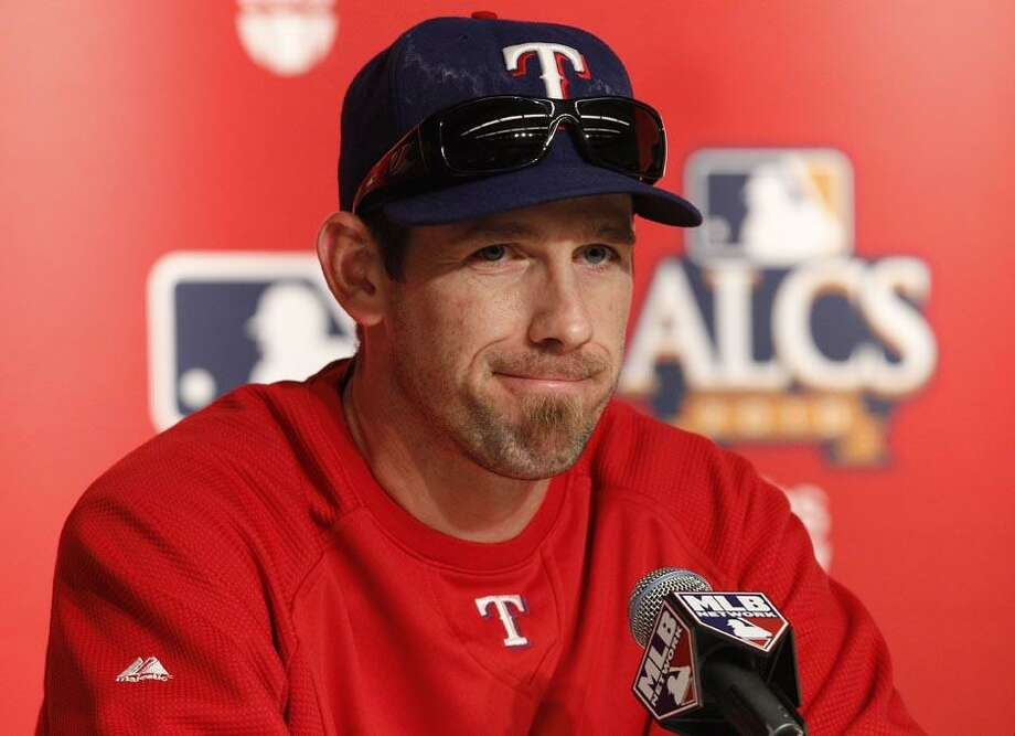Texas Rangers Game 3 starting pitcher Cliff Lee speaks during an American League Championship Series baseball news conference at Yankee Stadium in New York, Sunday. (AP Photo/Kathy Willens) Photo: AP / AP