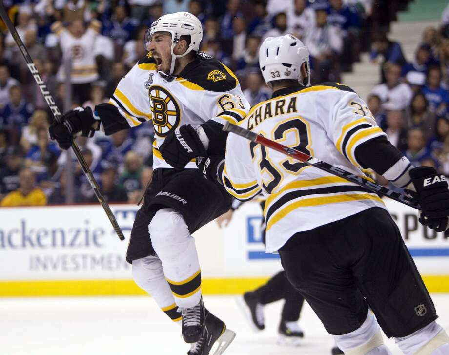Boston Bruins left wing Brad Marchand celebrates with Zdeno Chara after scoring against the Vancouver Canucks during the second period of Game 7 of the NHL hockey Stanley Cup Finals on Wednesday, June 15, 2011, in Vancouver, British Columbia. (AP Photo/The Canadian Press, Darryl Dyck) Photo: ASSOCIATED PRESS / AP2011