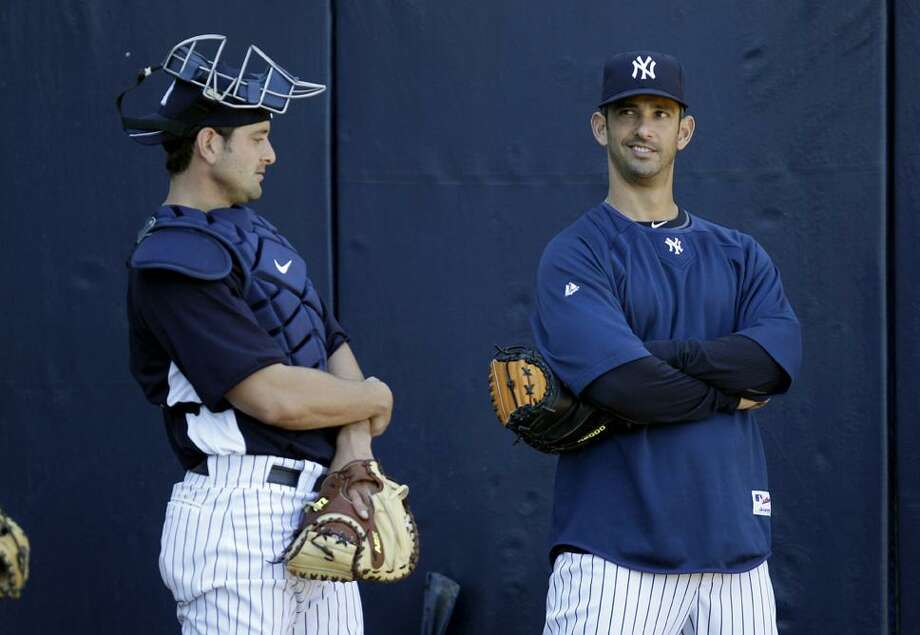 during the first day of pitchers and catchers at a baseball spring training workout Tuesday, Feb. 15, 2011, at Steinbrenner Field in Tampa, Fla. (AP Photo/Charlie Neibergall)