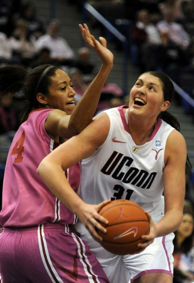 Connecticut's Stefanie Dolson comes under Oklahoma's Nicole Grifffin for a shot in the second half of an NCAAwomen's college basketball game in Hartford, Conn., Monday, Feb. 14, 2011. UConn defeated Oklahoma 86-45.  (AP Photo/Bob  Child)