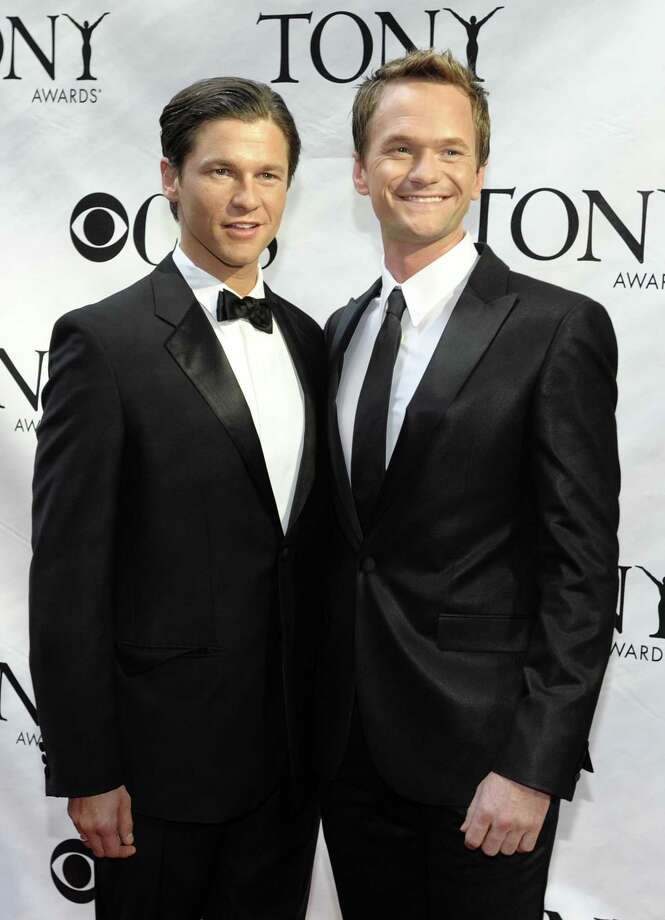 FILE - In this June 7, 2009 file photo, actor Neil Patrick Harris, right, and David Burtka arrive at the 63rd Annual Tony Awards in New York. (AP Photo/Peter Kramer, file) Photo: AP / KRAPE