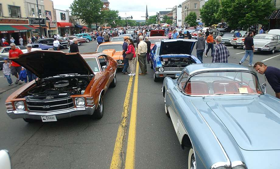Visitors check out cars at the annual car cruise on Main Street in Middletown during last summer's car cruise. (Brenda De Los Santos