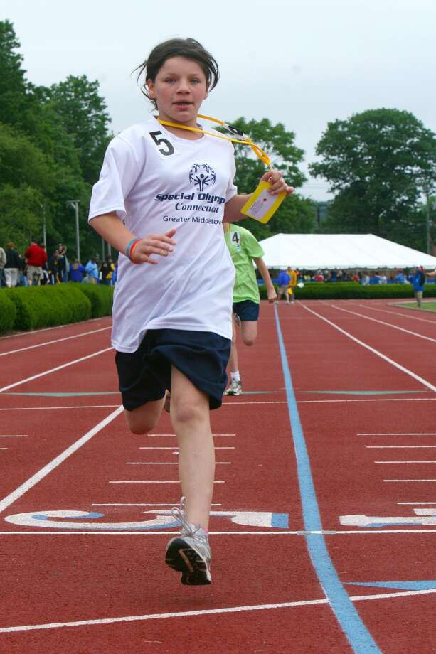SUBMITTED PHOTO - Greater Middletown Special Olympian Essence Rios crosses the finish line in the 100-meter run at the Connecticut Special Olympics Summer Games at Yale. Rios came in first place in this event, and also earned a gold medal in the 200-meter run.