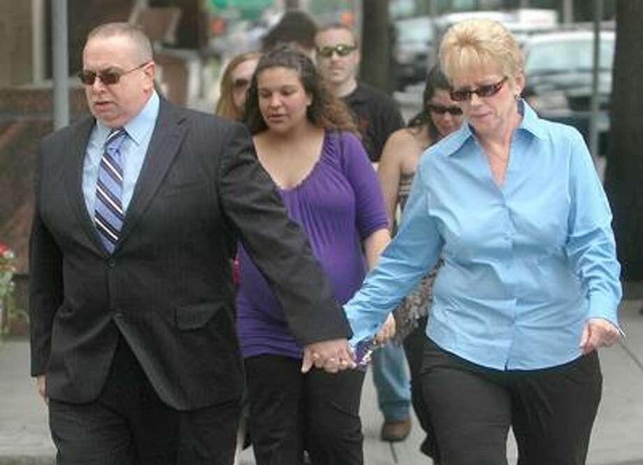 Raymond Clark Jr. and Diane Clark, parents of Raymond Clark III, enter New Haven County Court Wednesday morning. (Brad Horrigan