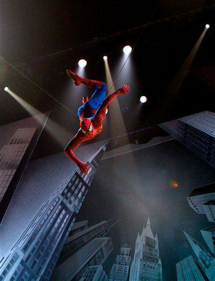 """In this theater publicity image released by The O and M Co., the Spider-Man character is suspended in the air in a scene from the musical """"Spider-Man: Turn Off the Dark,"""" in New York. (AP Photo/The O and M Co., Jacob Cohl) Photo: AP / The O and M Co."""