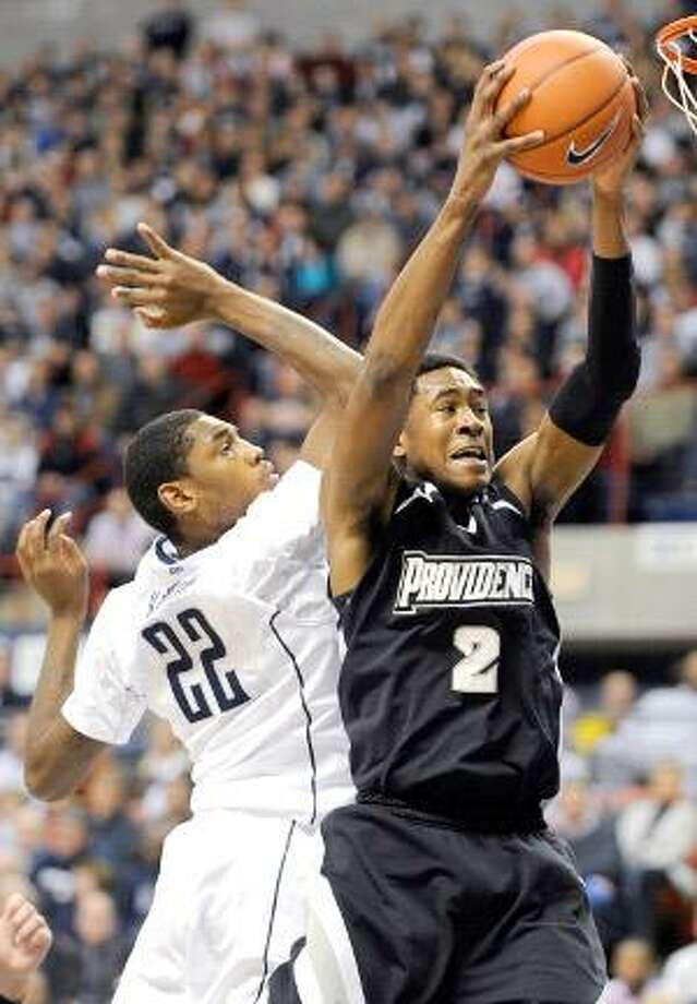 AP Providence's Marshon Brooks, right, grabs a rebound from Connecticut's Roscoe Smith during the first half of their game in Storrs on Sunday. The Huskies won 75-57.