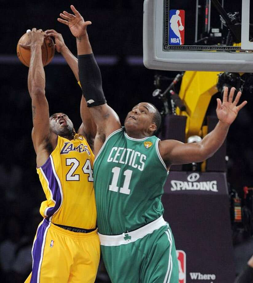 Los Angeles Lakers guard Kobe Bryant pulls down a rebound against Boston Celtics forward Glen Davis during the first half of Game 6 of the NBA basketball finals Tuesday. (AP) Photo: ASSOCIATED PRESS / AP
