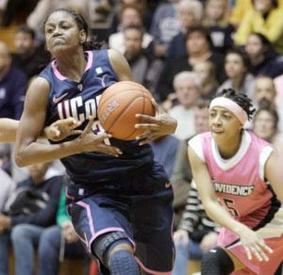 AP Connecticut guard Tiffany Hayes (3) makes a move toward the basket during the second half of Saturday's game against Providence at Alumni Hall on the Providence College campus in Providence, R.I. Connecticut defeated Providence 68-38. The Huskies face Oklahoma Monday.