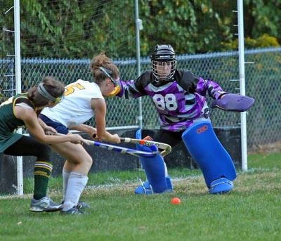 Mercy defender Caroline Woods and goalie Erika Nicholas team up to keep the cage clear against Hamden, Sept. 23. (Todd Kalif