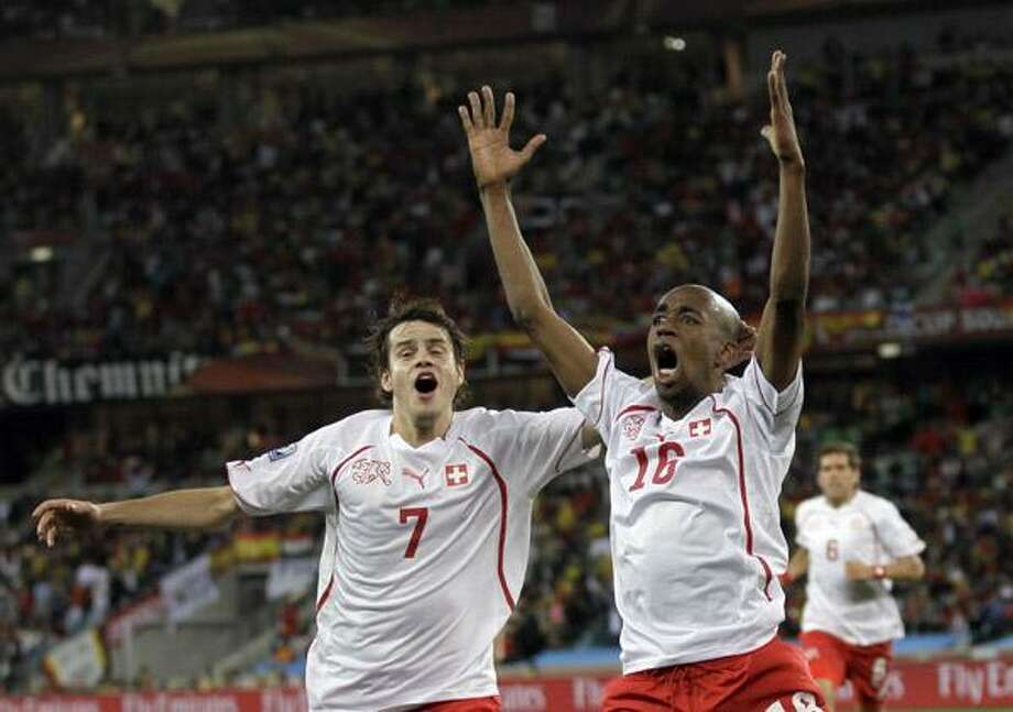 Switzerland's Gelson Fernandes, right, celebrates with his teammate Tranquillo Barnetta after scoring during the World Cup group H soccer match between Spain and Switzerland at the stadium in Durban, South Africa, Wednesday. (AP) Photo: ASSOCIATED PRESS / AP