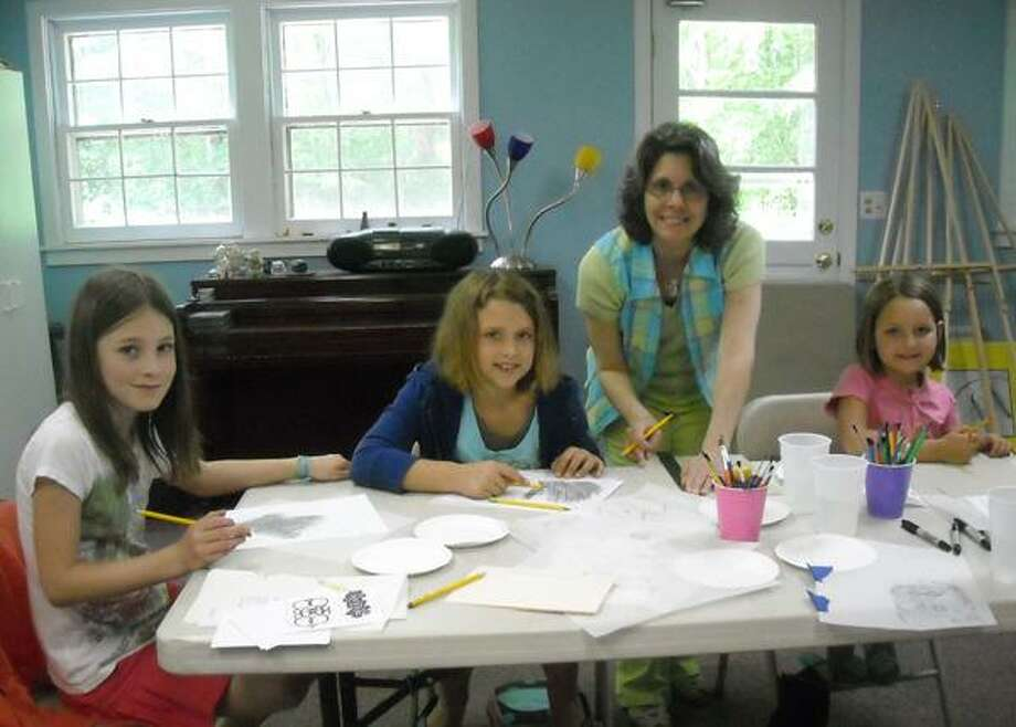 Art teacher Gloria Nilsson instructs students at The Arts Center at Killingworth. (Submitted photo)