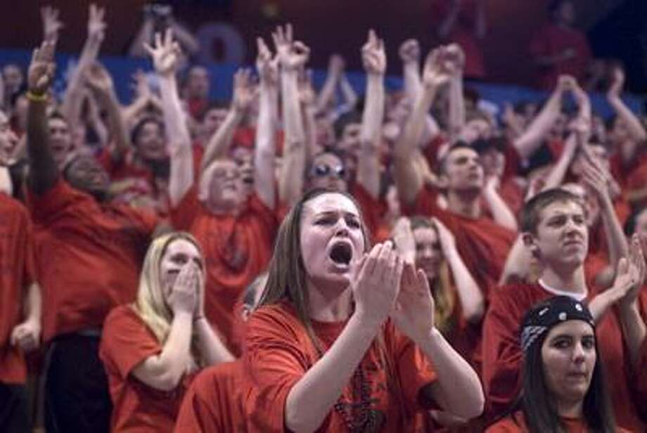 The Portland student section cheer wildly during the Class S girls basketball state championship game last Saturday against St. Paul Catholic. Portland's student section took second best to Xavier in Bransfield's Best Student Sections of the winter. (Max Steinmetz / Special to the Press)