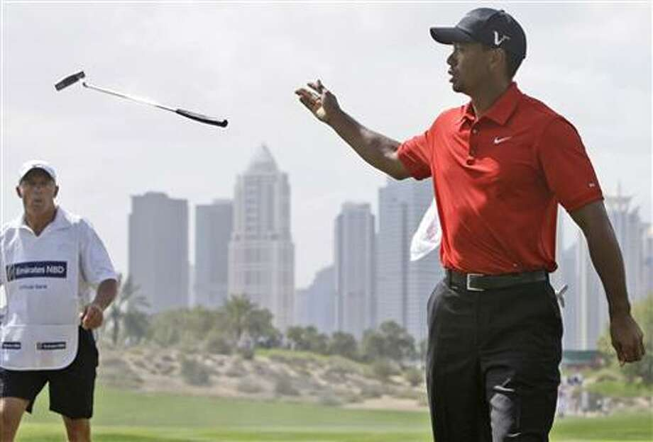 Tiger Woods from U.S. throws a club to his caddy Steve Williams on the 2nd hole during the final round of Dubai Desert Classic golf tournament at the Emirates Golf Club in Dubai, United Arab Emirates, Sunday Feb. 13, 2011. (AP Photo/Kamran Jebreili) Photo: ASSOCIATED PRESS / AP2011