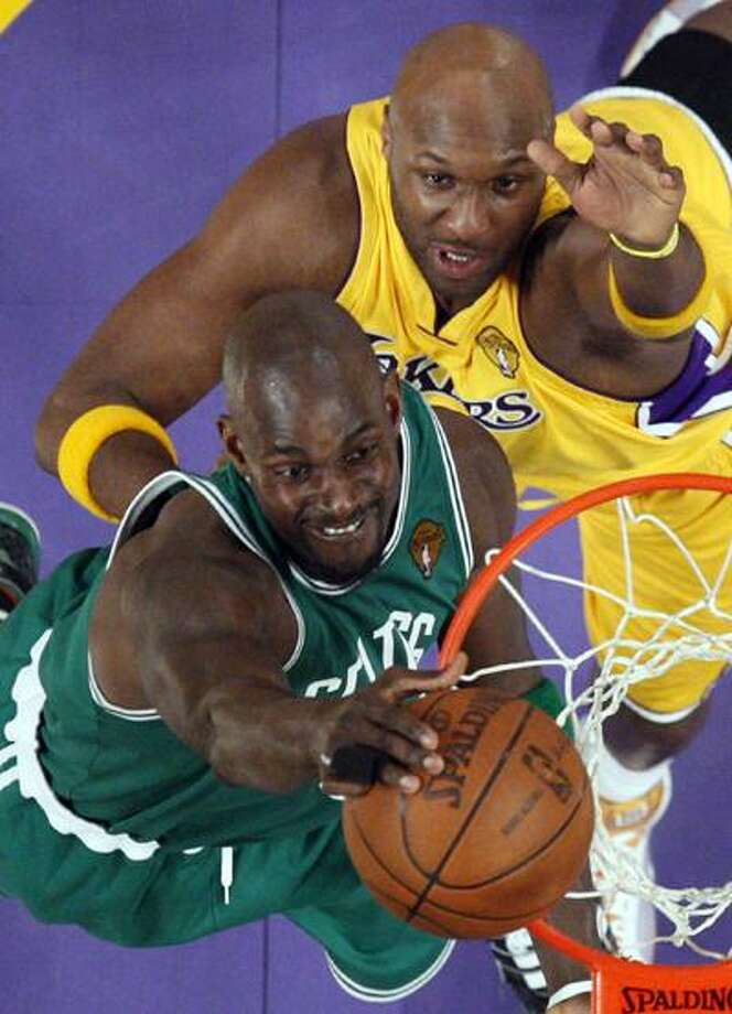 Boston Celtics forward Kevin Garnett, below, puts up a shot as Los Angeles Lakers forward Lamar Odom defends during the second half in Game 1 of the NBA basketball finals, Thursday. Two weeks later it's Game 7 with the NBA Championship hanging in the balance. (AP) Photo: ASSOCIATED PRESS / AP2010