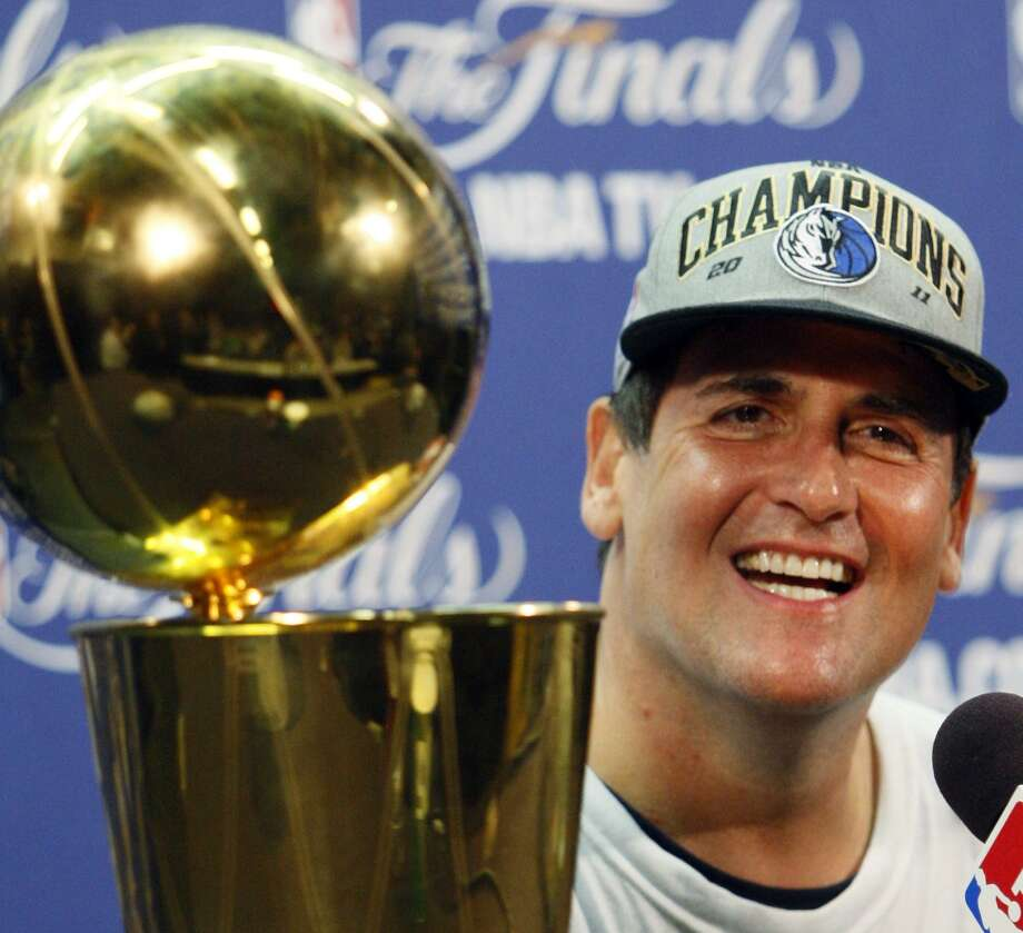 Dallas Mavericks owner Mark Cuban smiles during a news conference after Game 6 of the NBA Finals basketball game against the Miami Heat Sunday, June 12, 2011, in Miami. The Mavericks won 105-95 to win the series. (AP Photo/Wilfredo Lee) Photo: ASSOCIATED PRESS / AP2011