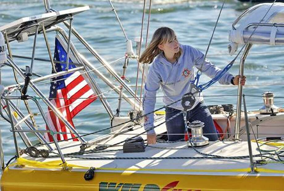 In this Jan 23 file photo, Abby Sunderland, 16, looks out from her sailboat, Wild Eyes, as she leaves for her world record attempting journey at the Del Rey Yacht Club in Marina del Rey, Calif. Sunderland who was feared lost at sea while sailing solo around the world has been found alive and well, adrift in the southern Indian Ocean with rescue boats headed toward her, officials said. (AP) Photo: AP / FR170105 AP