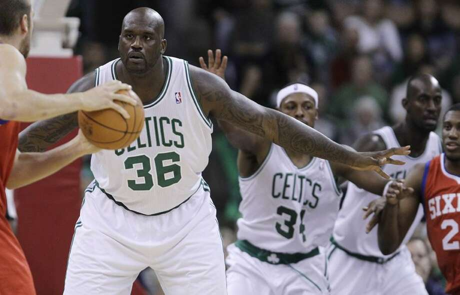Boston Celtics center Shaquille O'Neal (36) defends against the Philadelphia 76ers with teammates Paul Pierce, center, and Kevin Garnett during the first half of an preseason NBA basketball game in Manchester, N.H., Wednesday, Oct. 6, 2010. (AP Photo/Charles Krupa) Photo: AP / AP