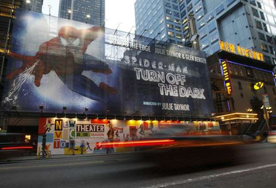 "FILE - An Oct. 5, 2010 file photo shows a banner covering the front of the Foxwoods Theater on 42nd street in New York for the play Spider-Man: Turn off the Dark.  The Broadway production of ""Spider-Man: Turn Off the Dark,"" plagued by financial problems and injuries including a stunt man's 30-foot fall after his safety harness malfunctioned, has delayed its opening night for a third time, Thursday, Jan. 13, 2011. (AP Photo/Kathy Willens/file) Photo: ASSOCIATED PRESS / AP2010"