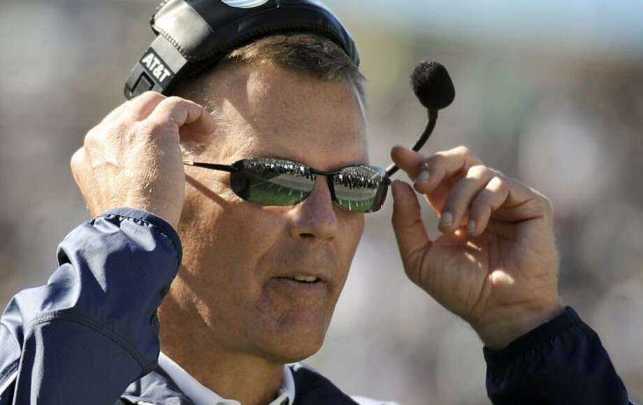 Connecticut head coach Randy Edsall adjusts his sunglasses during the first half of a NCAA college football game against Vanderbilt in East Hartford Saturday, Oct. 2.(AP Photo/Jessica Hill) Photo: AP / AP2010