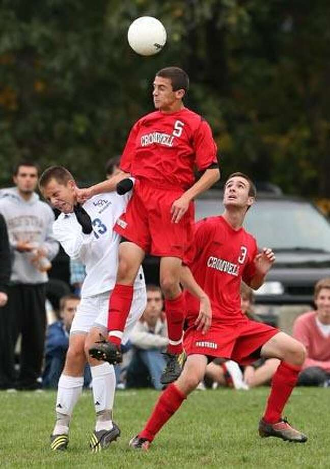 Cromwell's James Iannicelli out-jumps Old Lyme's Jeff Winters to head the ball Thursday. (Todd Kalif
