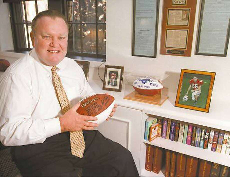 This 1997 photo shows Robert Burton in his Greenwich, Conn.  office.  Burton, a major benefactor to the University of Connecticut wants the school to return $3 million in donations and remove his family name from its football complex because he says he was shut out of discussions about the selection of a new football coach.   Burton, chief executive officer of Greenwich, Conn.-based Burton Capital Management, said in a Jan. 19 letter to UConn athletic director Jeff Hathaway that his opinions were ignored and he did not support the way Paul Pasqualoni was selected as coach.  (AP Photo/Greenwich Time,  Bob Luckey) Photo: AP / Greenwich Time