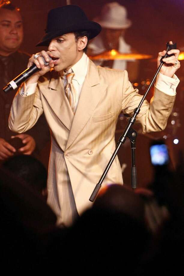 In this July 17, 2007, file photo, Prince performs during a jam session in the Montreux Jazz Cafe after his concert at the 41st Montreux Jazz Festival, in Montreux, Switzerland. (AP) Photo: ASSOCIATED PRESS / KEYSTONE