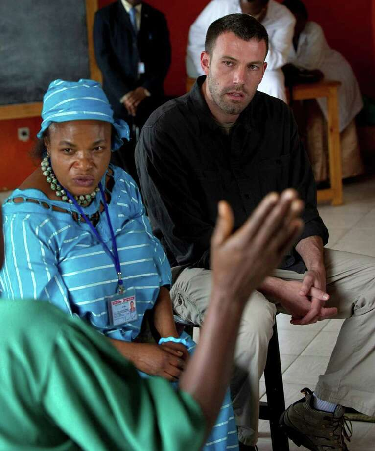 In this photo taken March 18,  Ben Affleck, right, founder of the Eastern Congo Initiative, sits beside an official of the Eastern Congo Initiative, left, as they listen to a survivor of sexual violence talk, partially seen foreground left, at Aid Group HEAL Africa's premises in Goma, Democratic Republic of Congo. Affleck launched a new initiative Monday to raise money and awareness over atrocities committed against women and children during years of conflict in eastern Congo, Affleck told The Associated Press. (AP)