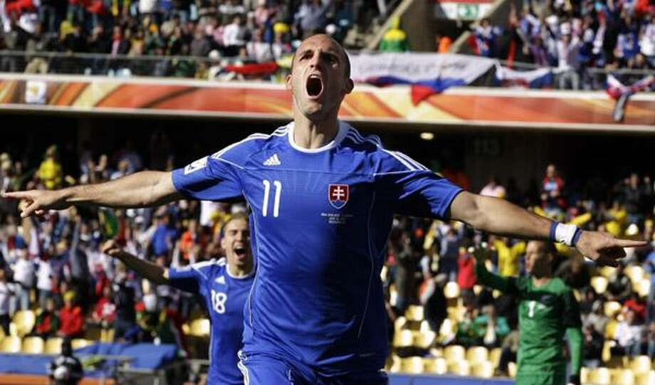 Slovakia's Robert Vittek celebrates after scoring the opening goal during the World Cup group F soccer match between New Zealand and Slovakia at Royal Bafokeng Stadium in Rustenburg, South Africa, on Tuesday. (AP) Photo: ASSOCIATED PRESS / AP