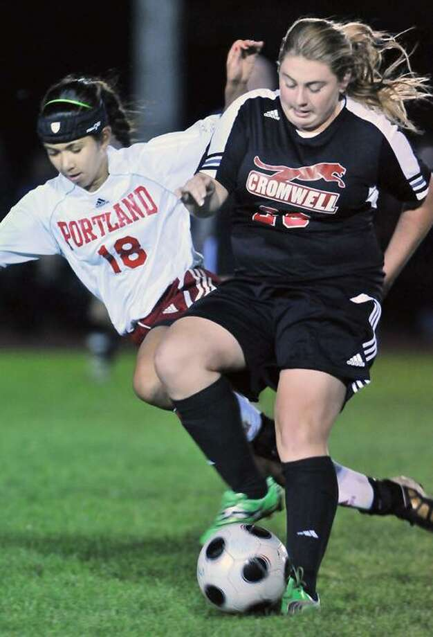 The Middletown Press  10.3.11 Portland senior captain Rachel DeBarge takes control of the play against Cromwell sophomore Erin Glynn Monday night in Cromwell. The Portland Highlanders defeated the Cromwell Panthers 4-0.  To buy a print of this photo and more, visit www.middletownpress.com