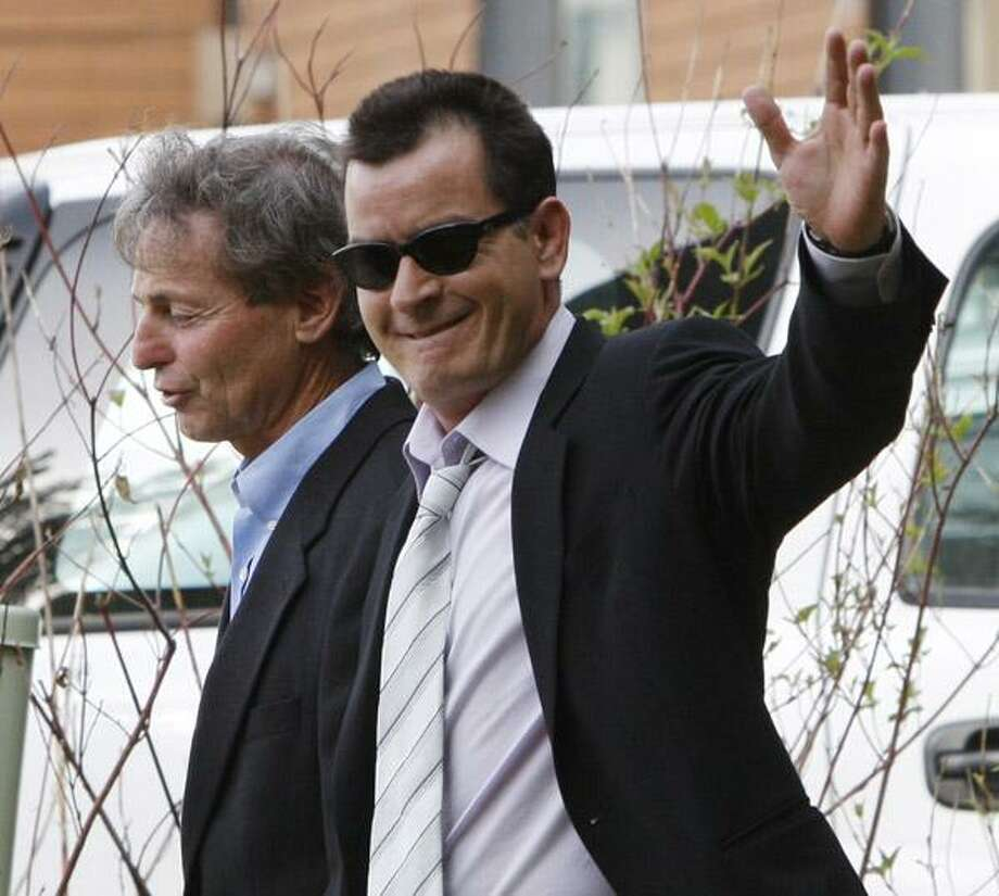 Charlie Sheen, right, leaves the Pitkin County Courthouse with his attorney Richard Cummins in Aspen, Colo., on Monday, June 7. (AP) Photo: ASSOCIATED PRESS / AP