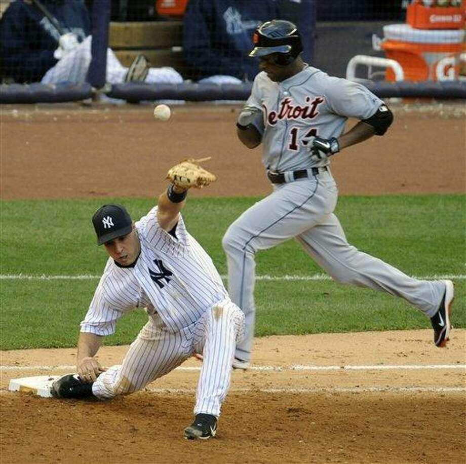 Detroit Tigers' Austin Jackson, right, is safe on a throwing error by New York Yankees' Derek Jeter as Yankees first baseman Mark Teixeira cannot come up with the ball in the sixth inning during Game 2 of baseball's American League division series Sunday, Oct. 2, 2011, at Yankee Stadium in New York. (AP Photo/Bill Kostroun) Photo: AP / FR51951 AP