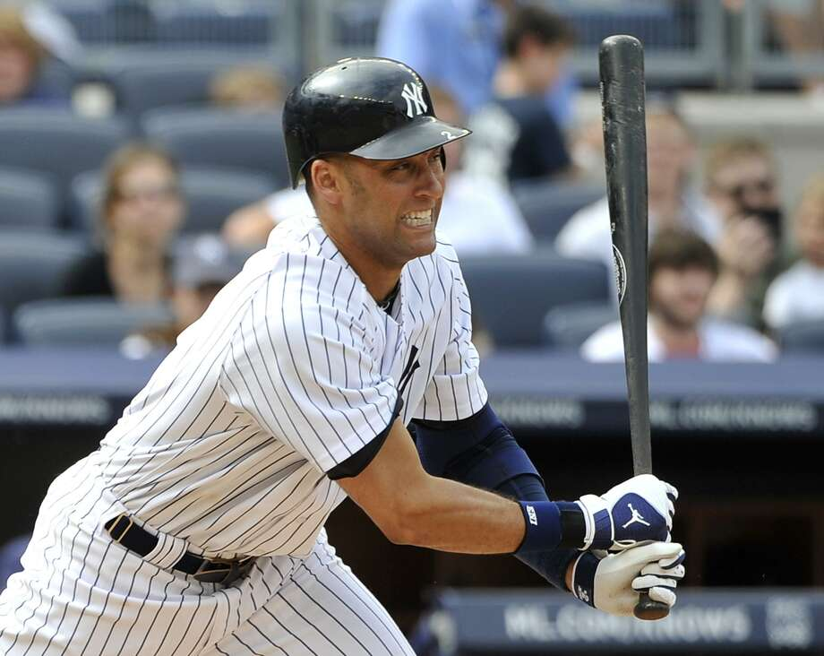 New York Yankees shortstop Derek Jeter hits an RBI single off of Cleveland Indians' Chad Durbin in the eighth inning   of a baseball game Sunday, June 12, 2011, in New York. Jeter hit two RBI singles during the Yankees' 9-1. (AP Photo/Kathy Kmonicek) Photo: ASSOCIATED PRESS / AP2011