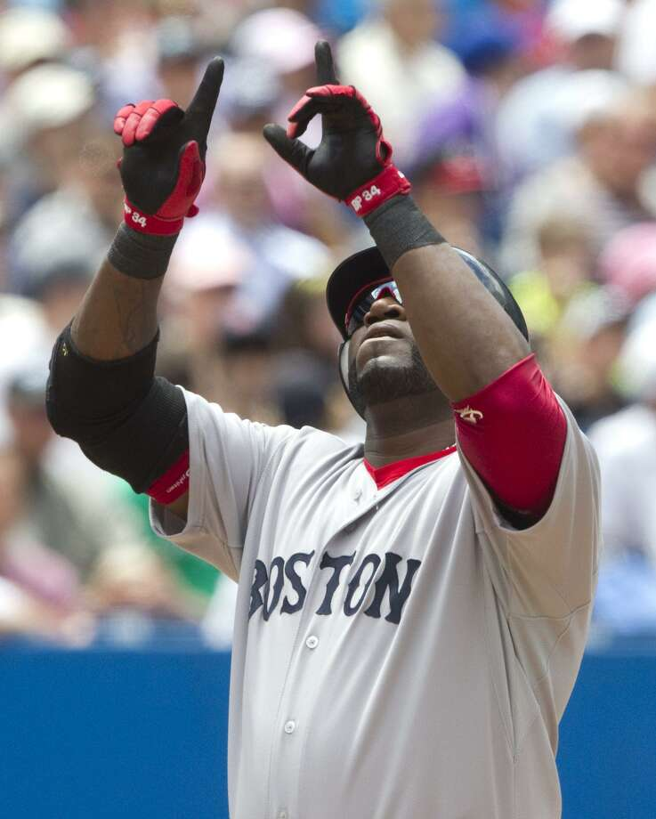 Boston Red Sox's David Ortiz celebrates a three-run home run in the fifth inning of MLB baseball game action against the Toronto Blue Jays in Toronto, Sunday, June 12, 2011. (AP Photo/The Canadian Press, Darren Calabrese) Photo: ASSOCIATED PRESS / AP2011