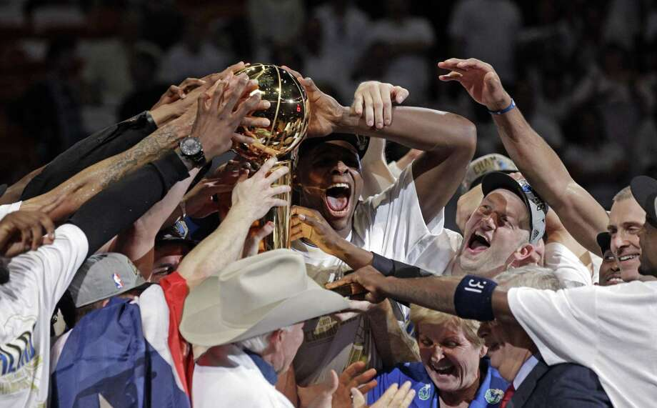 The Dallas Mavericks celebrate after Game 6 of the NBA Finals basketball game against the Miami Heat Sunday, June 12, 2011, in Miami. The Mavericks won 105-95 to win the series. (AP Photo/David J. Phillip) Photo: ASSOCIATED PRESS / AP2011