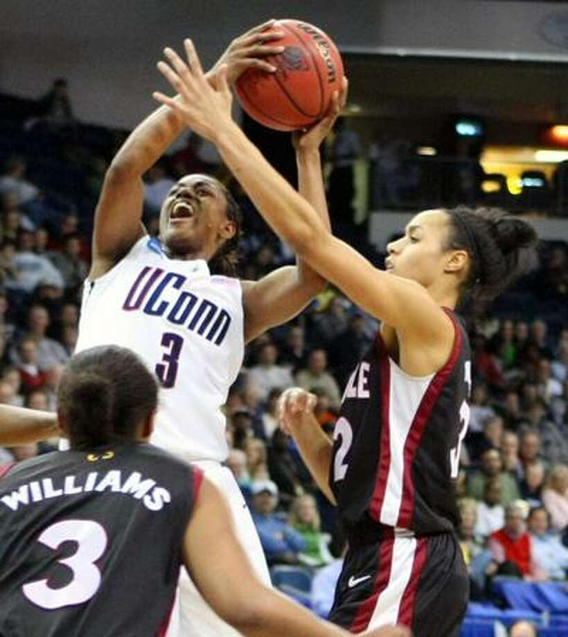 Connecticut's Tiffany Hayes, left, shoots over Temple's Natasha Thames, right and B.J. Williams, left, during the first half of Tuesday's NCAA second round tournament game. (Associated Press) Photo: ASSOCIATED PRESS / AP2010