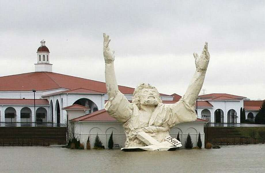 """In this March 19, 2008, file photo, the """"King of King's"""" statue of Jesus Christ stands outside of Solid Rock Church in Monroe, Ohio. The six-story-tall statue of Jesus with his arms raised along a highway was struck by lightning in a thunderstorm Monday night, June 14, and burned to the ground, police said. Photo: ASSOCIATED PRESS / The Journal"""
