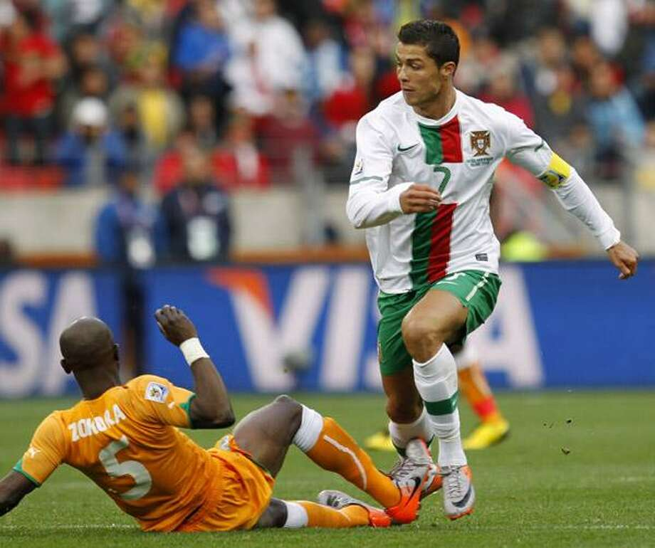 Ivory Coast's Didier Zokora, left, fouls Portugal's Cristiano Ronaldo during the World Cup group G soccer match between Ivory Coast and Portugal at Nelson Mandela Bay Stadium in Port Elizabeth, South Africa, Tuesday. Photo: ASSOCIATED PRESS / AP